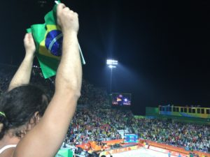 A Brazilian fan celebrates a point for her country at the Beach Volleyball