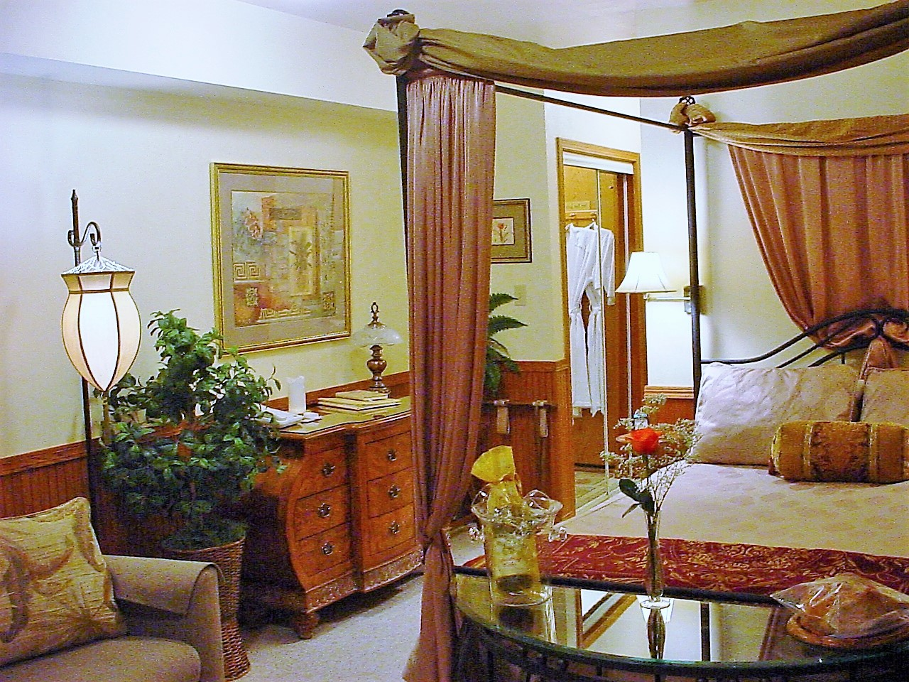 Photo of bed and dresser in Forest View deluxe studio at Pearson's Pond Luxury Inn and Adventure Spa.