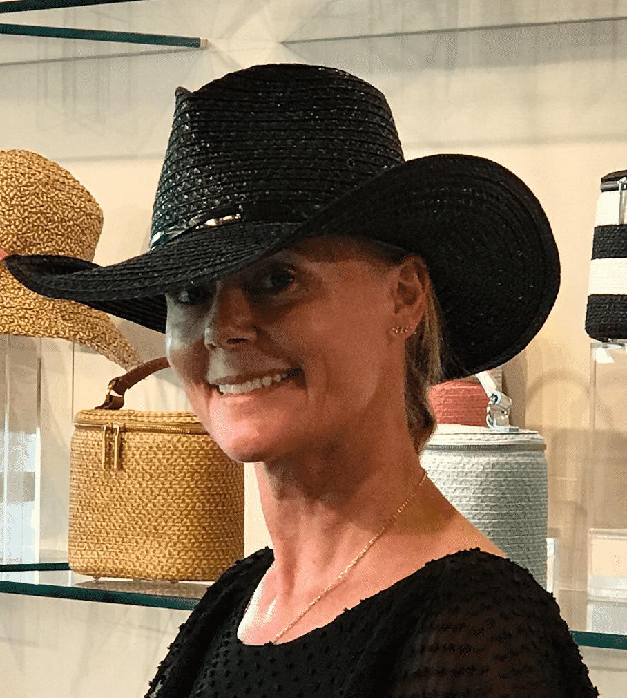 HIlary Dick modeling hat at Eric Javits Showroom.
