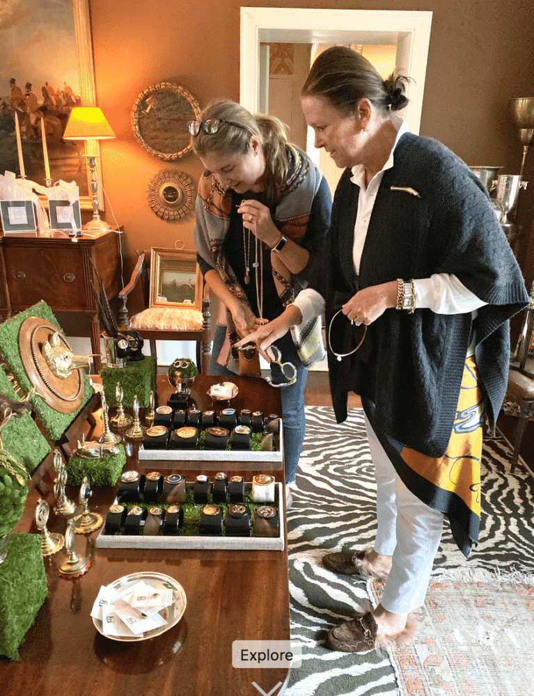 Whitney Baldwin designs helping Daphne Richards pick a piece of jewelry.