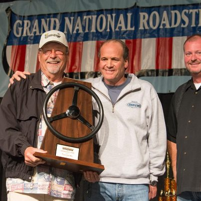 "Congratulations to our Founder and Chairman Gary Meadors on receiving the Brizio Family ""Driven"" award at last weekend's Grand National Roadster Show! Roy Brizio (center) presented the award to Gary while show promoter John Buck (right) looks on. Photo courtesy of Scott Killeen www.teamkilleen.com"