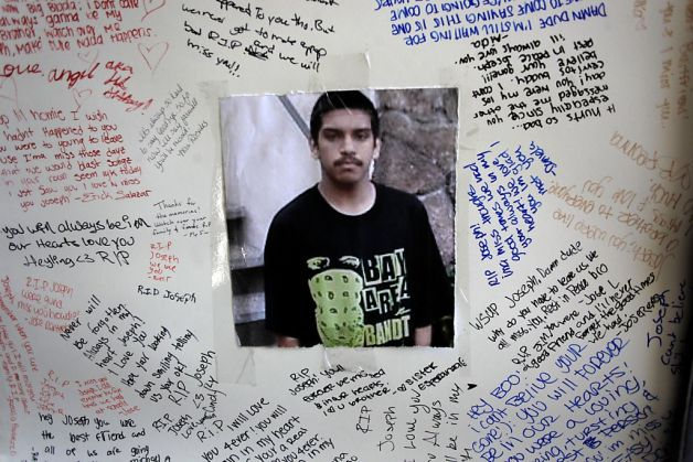 A poster to remember the 14-year-old at his South San Francisco, CA home, on Tueasday September 27, 2011, which was signed by family and friends during a memorial service over the weekend. Joseph Maharaj, was shot and killed near his home on September 18th.  Photo: Michael Macor, The Chronicle