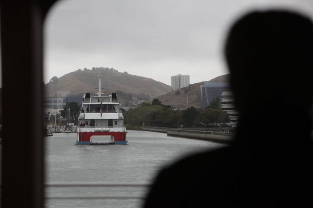 A passenger aboard the ferry Gemini watches the ferry Pisces (left) head back to the Oyster Point Marine Ferry Terminal after a bay cruise during the San Francisco Bay Ferry South San Francisco Inaugural Celebration. Photo: Lea Suzuki, The Chronicle