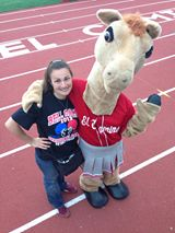 Angelique Presidente and COLT Mascot mugging for the camera Photo AP