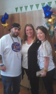 Juliana's parents Jesus and Patricia pictured with event coordinator Silva Wolfe