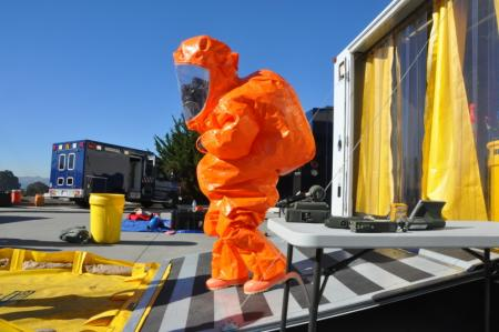 The 95th Civil Support Team decontamination specialist Staff Sgt. Leslie Greenfield emerges from a decontamination trailer wearing a Level A Hazmat suit after decontaminating entry teams during Operation Pure Cure on Jan. 22, 2014, in South San Francisco Photo: Capt Jason Sweeney