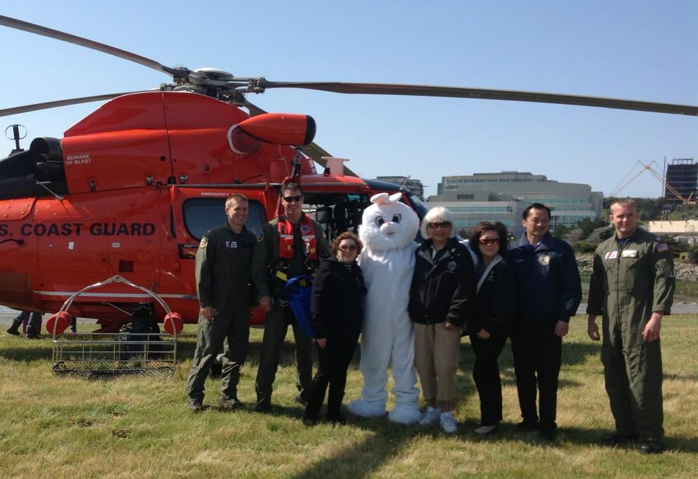 SSF Chamber CEO Maria Martinucci and Mayor Karyl Matsumoto pose with the Easter Bunny along with Councilwoman Liza Normandy and SMC Harbor District Commissioner Robert Bernardo, flanked by our US Coast Guard at Oyster Point for the Easter Fun Activities Photo: Everything South City