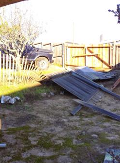 Kathy Altizio Tetreault lost a fence in the fierce winds