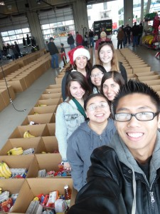 Young volunteers help pack holiday food boxes for the Louis P. Guaraldi Food Basket Program in December 2014 at SSF Fire Station 61. Photo Credit: Lisa DeMattei
