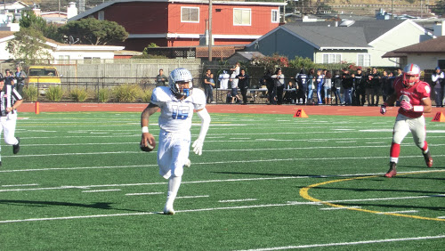 South City quarterback Kolson Pua rolls out on a six-yard run in the second quarter of the Bell Game, on Saturday, Nov. 14, 2015.  Photo by John Baker.