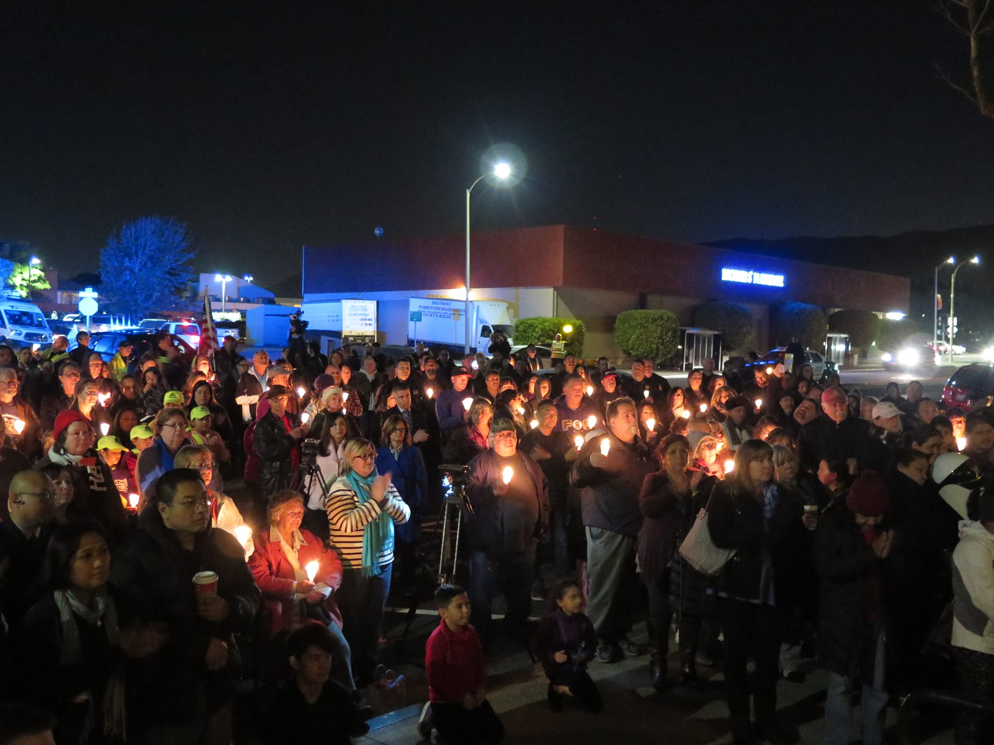 Not knowing the size of the crowd in advance, only 150 candles were available to pass out.  Photo: SSFPD