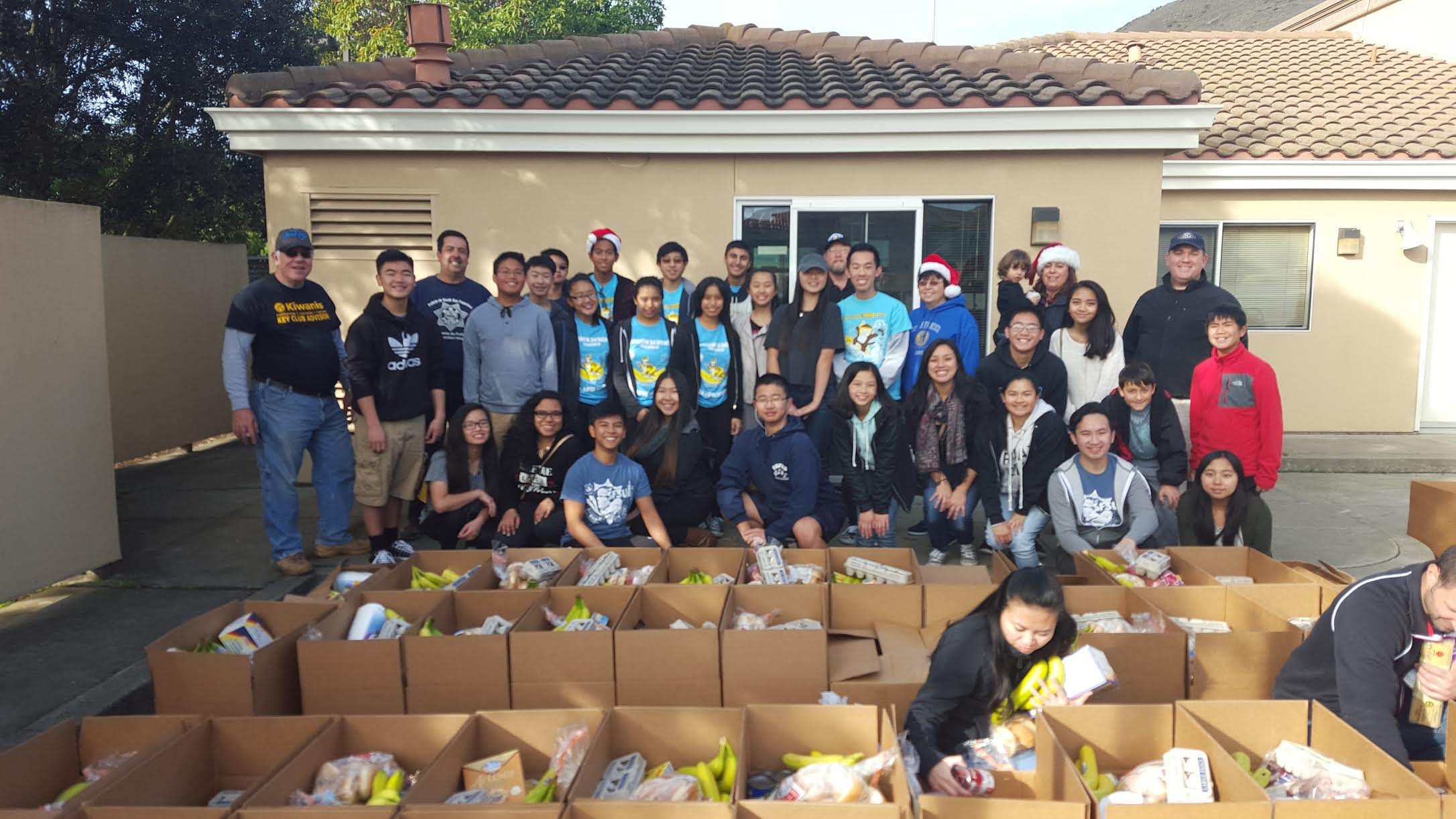 Kiwanis, Key Club, Circle K, and community volunteers helped pack holiday food boxes for the annual Louis P. Guaraldi Food Basket Program in December 2015 at SSF Fire Station 65. Photo Credit: Lisa DeMattei