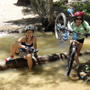 7 Tips to know before you mountain bike in Lake Tahoe. Friends on trail together.