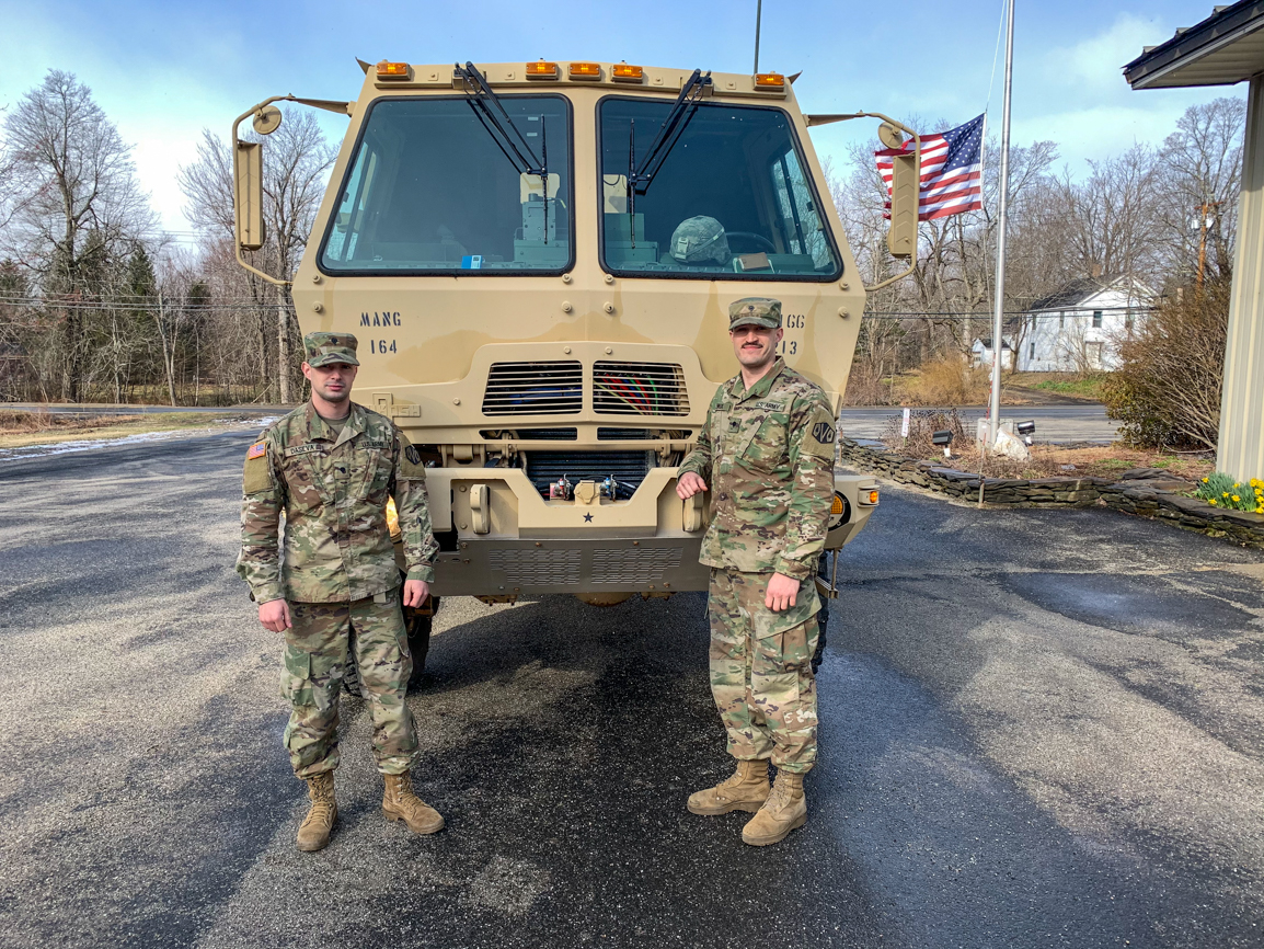 SPC Dasilva (left) and SPC Lemieux of the 1166th Transportation Unit out of Worcester