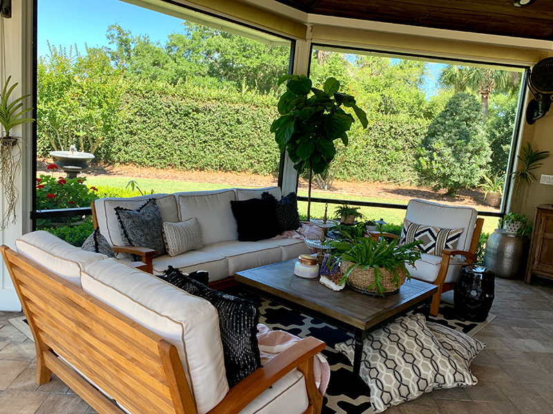 This corner of the patio falls into the Wealth Gua, which is governed by the Wood Element and the color purple. Well made teak furniture, an amethyst crystal and a fiddle leaf fig tree (wood and round leaves to represent coins - aka wealth) create harmony and balance.