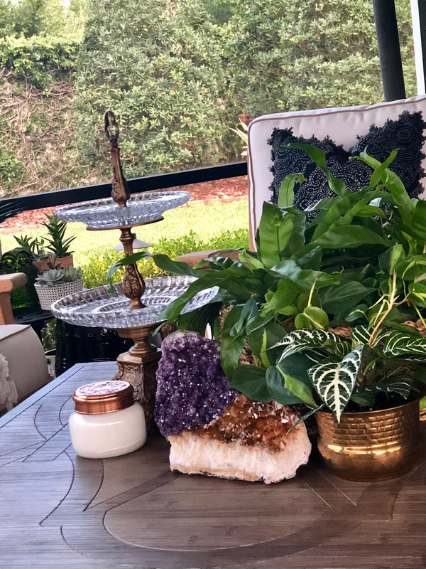 Wealth - Lush plants and crystals with a beautiful serving piece lend an aura of luxury to this area.