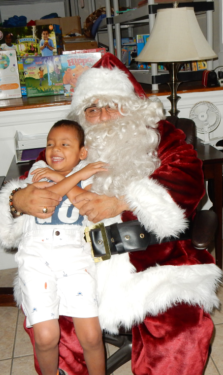 3 Big Santa with smaller little boy