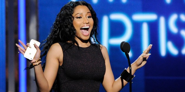 Nicki Minaj accepts the award for best female hip hop artist at the BET Awards at the Nokia Theatre on Sunday, June 29, 2014, in Los Angeles. (Photo by Chris Pizzello/Invision/AP)