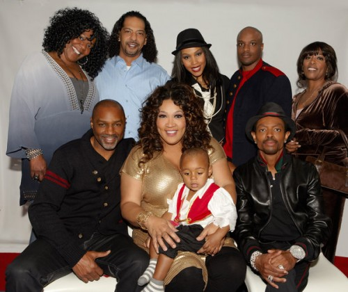 """Pictured is Kym Whitley, 2-year old Joshua, Rodney Van Johnson(L), Wendell James bottom right and, """"The Village""""  Photo credit:  OWN"""