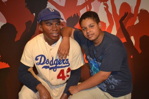 A,J. poses with Jackie Robinson at Madam Tussauds.