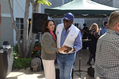 Former San Diego Charger, Willie Buchanon hits the dance floor with an attendee.