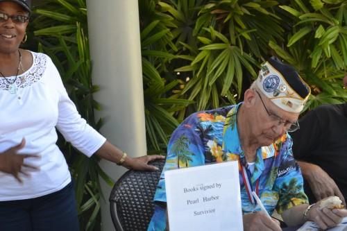 Pearl Harbor Survivor signs autographs.