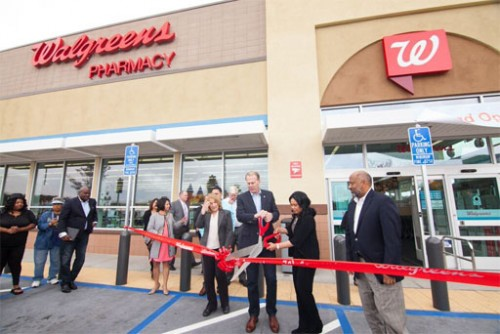 Left to right - Officials from Walgreens join Jacobs Center Board Member Valerie Jacobs Hapke, City of San Diego Mayor Kevin Faulconer, District 4 Councilmember Myrtle Cole, and Jacobs Center President and CEO Reginald Jones to officially cut-the ribbon to open the Walgreens near the corner of Market Street and Euclid Avenue.