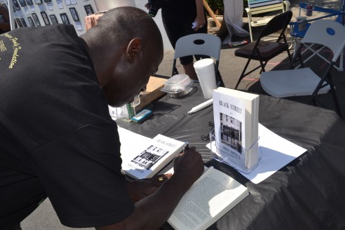"""Sidney Cooper, Jr., of Cooper Family Foundation was  at the event signing copies of his debut novel, """"Black Street"""""""