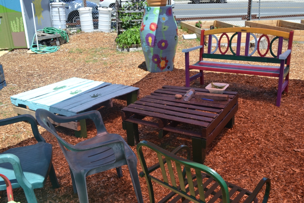 Colorful outdoor furniture adds a warm touch to Mt. Hope Community Garden.