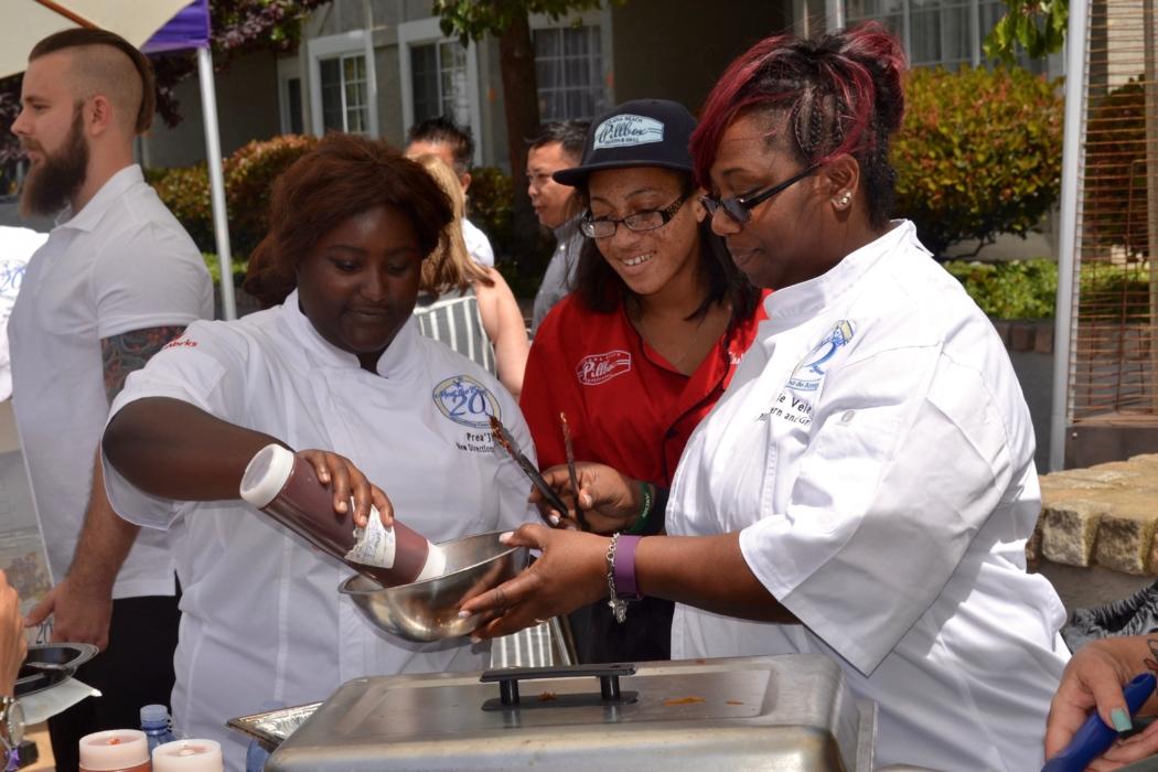 Chef Michele Velez of Pillbox Tavern & Grill, get assistance from Prea' of Casa de Amparo's New Direction Program