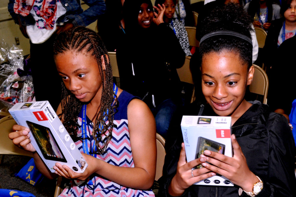 The reaction of the girl's face was priceless after learning that they would receive a tablet.
