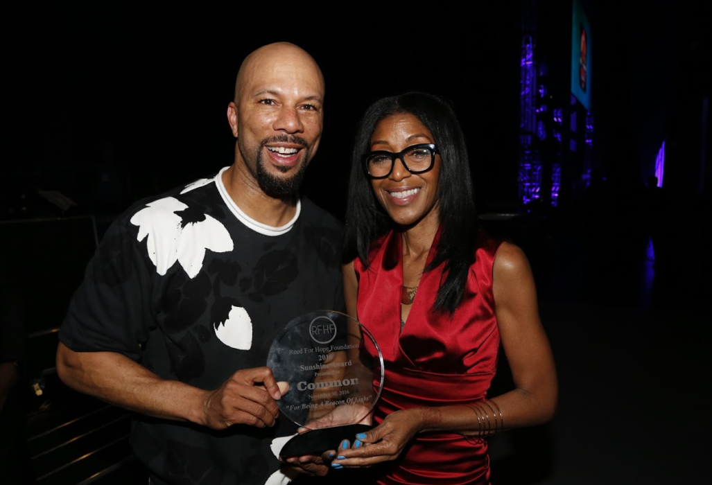 RFHF founder and Emmy Award-winning casting director, Robi Reed, presented the foundation's Sunshine Award to Common/
