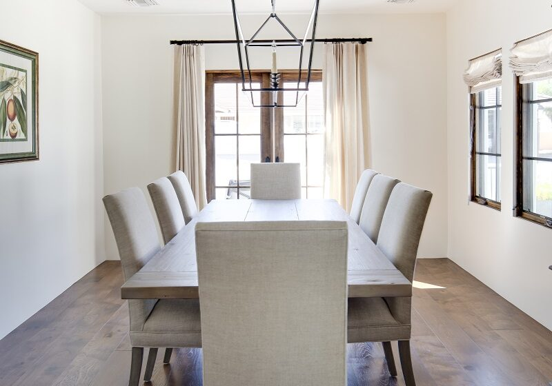 AFTER - This formal Dining Room is a great space for entretaining both in and outside. The elegant hardwood flooring  keeps this home warm and  the French doors open to the front patio with amazing views of Camelback Mountain.