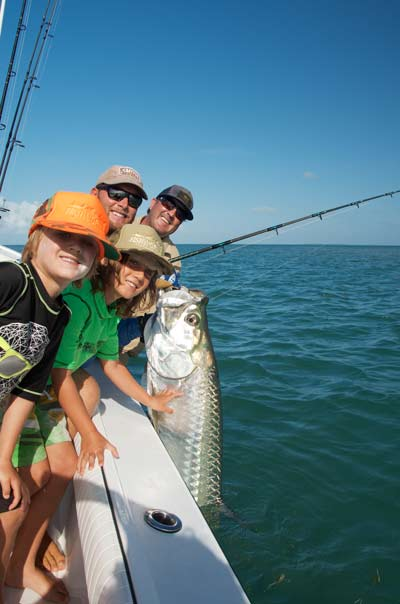 Kids pose next to their dad's tarpon he caught in Key West