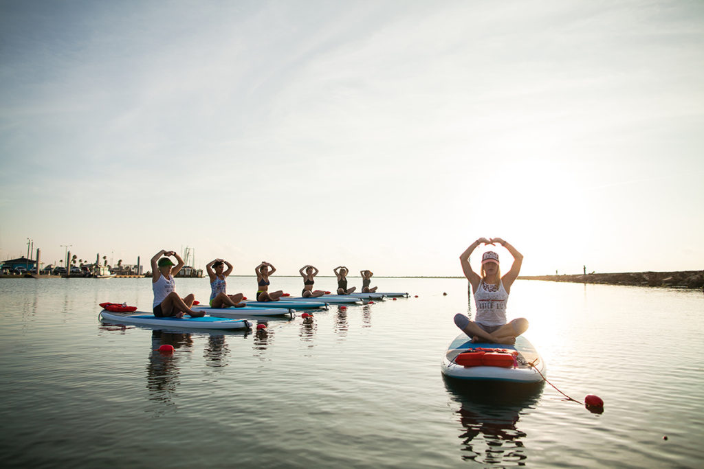 Sunrise on the water in Corpus Christi with Water Dog Floating Yoga