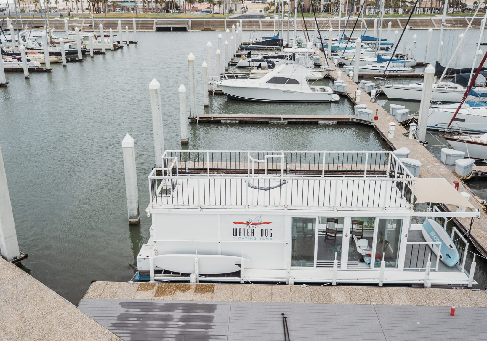 Yoga on the deck of the houseboat studio in the Corpus Christi Marina