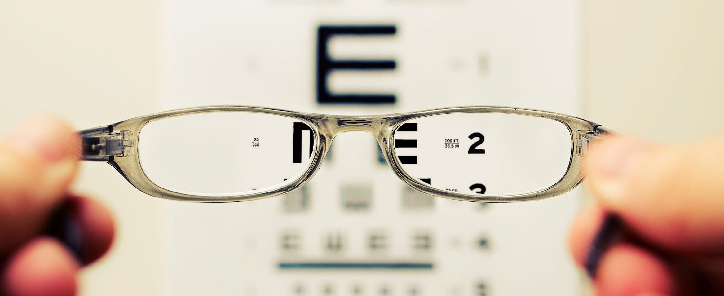 Vision test - hands holding eye glasses.