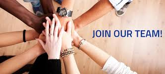 Join our Team - hands stacked together in a team huddle