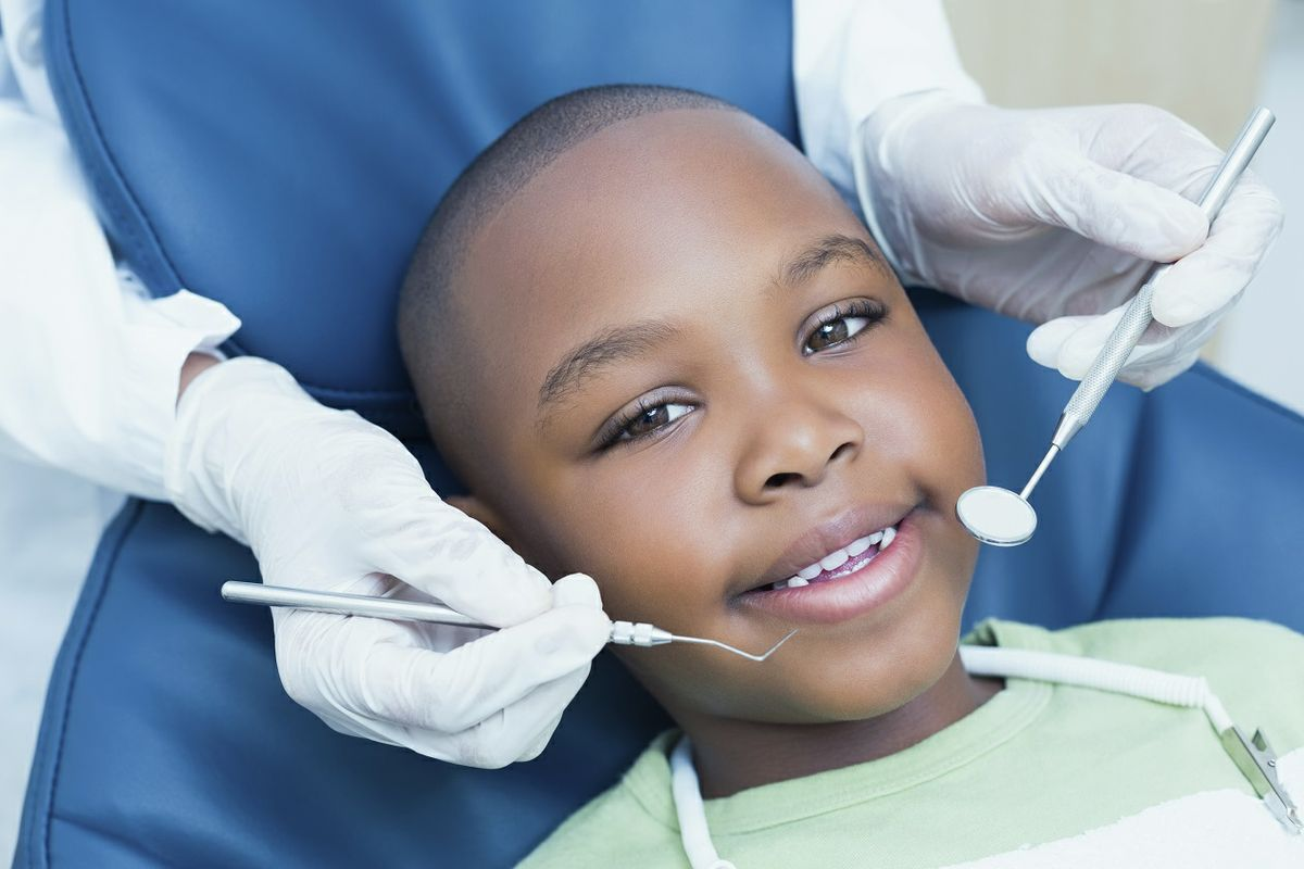 Child smiling at a dental exam