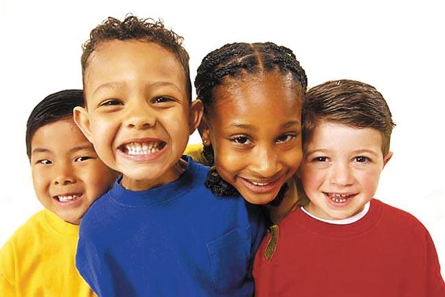 Children of different ethnicities smiling