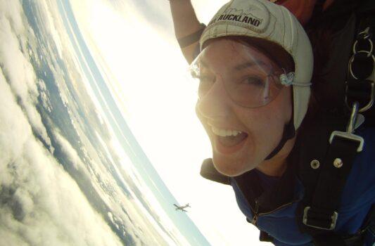 Woman skydiving smiling