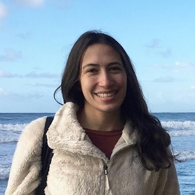 Cara Crawford standing in front of ocean wearing fleece