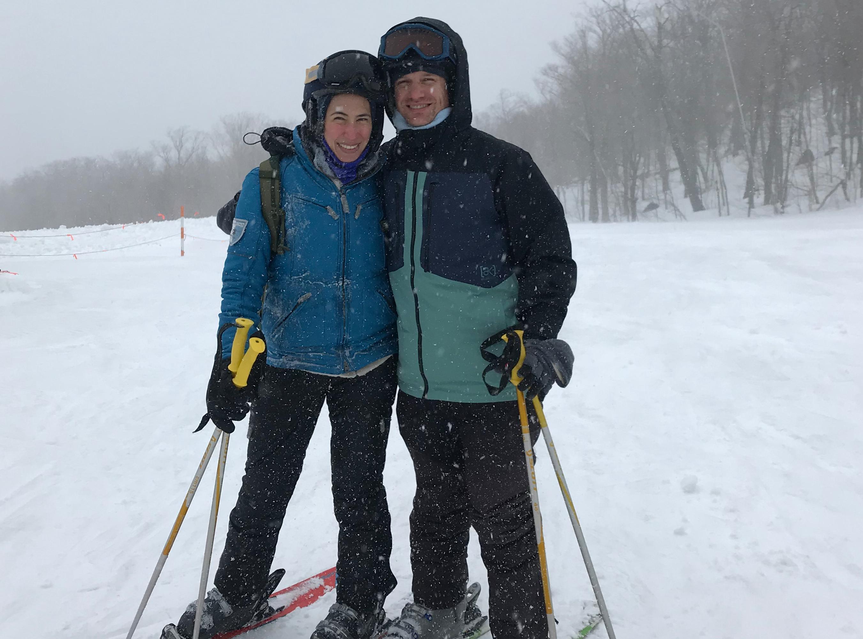 Cara Crawford and man posing on ski slope