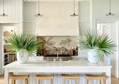 southern-living-idea-house-2019-heather-chadduck-kitchen-marble-countertops-island-barstools-mural