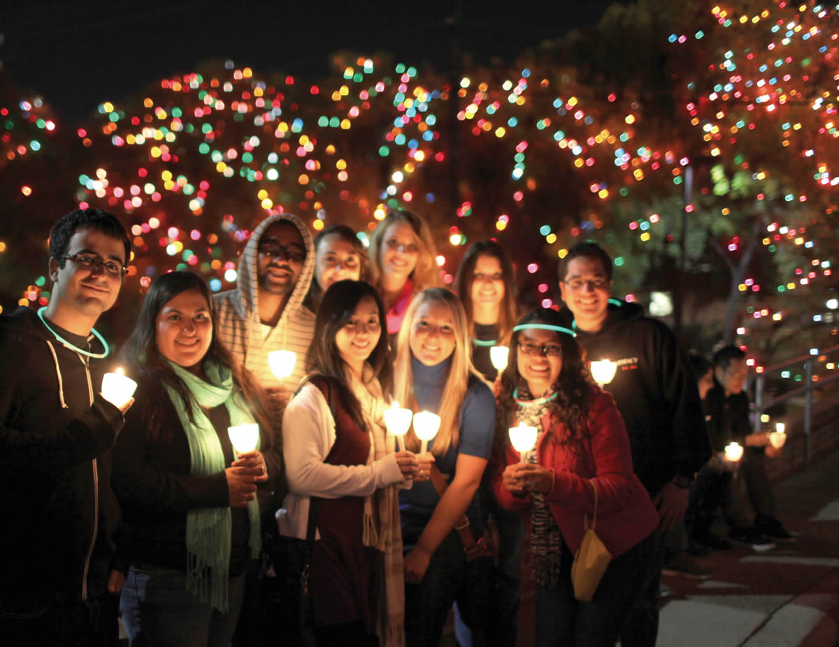 Students from UIW's Feik School of Pharmacy take a moment to enjoy the lights at UIW's 26th Annual Light the Way event held Nov. 17.