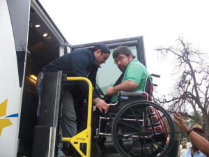 Alumnus Trey Ibarra assists a member of Trey's House during the non-profit's yearly trip to the Texas State Capitol.