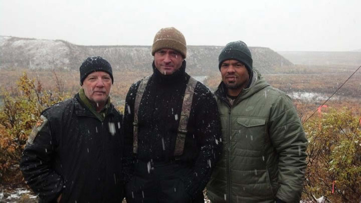 "Jake Zweig (right), assistant football coach, on location with fellow competitors of Animal Planet's upcoming reality series, ""Catch and Release."""