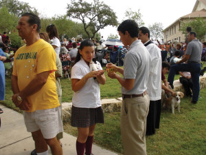 Vasquez blesses an animal during the Feast Day of St. Francis while in high school.