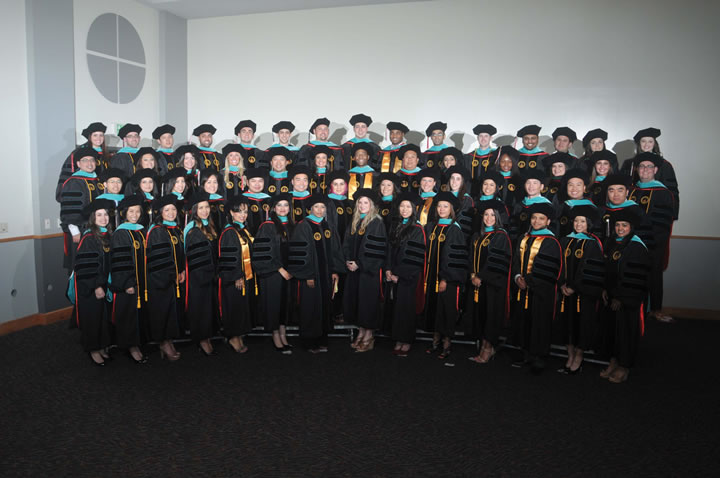 The inaugural class of RSO gathered at the Hooding Ceremony on May 9 in the McCombs Center Rosenberg Sky Room.