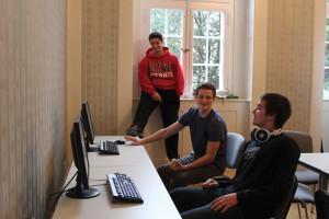 (Pictured L to R) Brody Rodriguez, David Craig and Evan Morris share a laugh in the ESC computer lab.